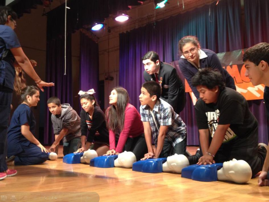 ATC Health students demonstrating CPR to 8th graders